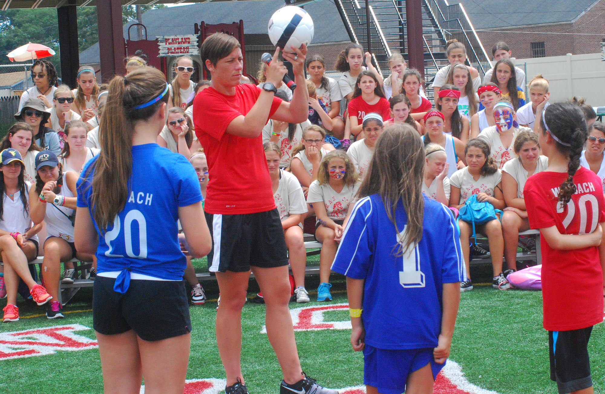 Wambach gave a lesson on heading the ball.
