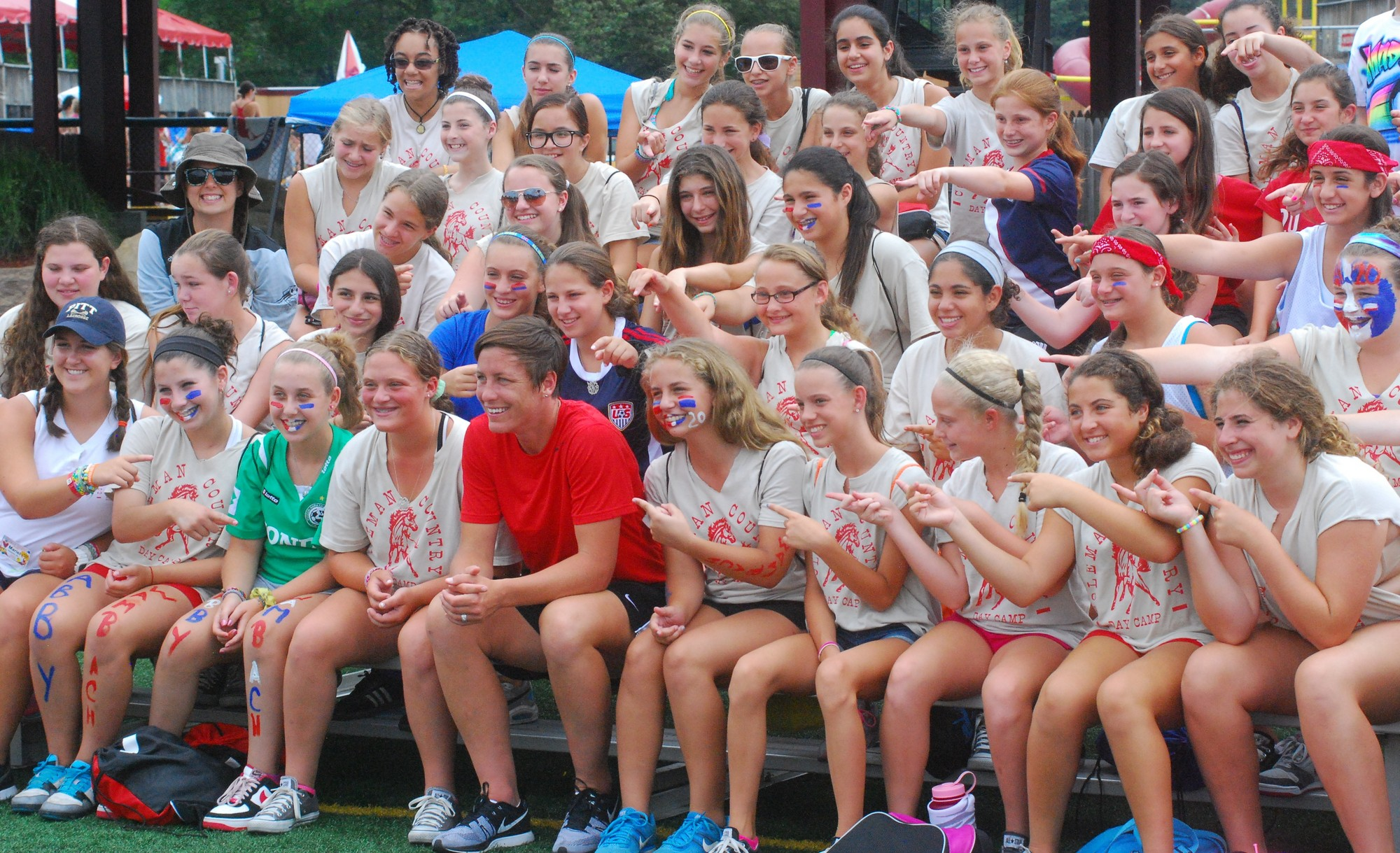 Wambach posed for group photos with campers.