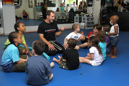 Sensei Joe Silbers talks to the kids after the session.