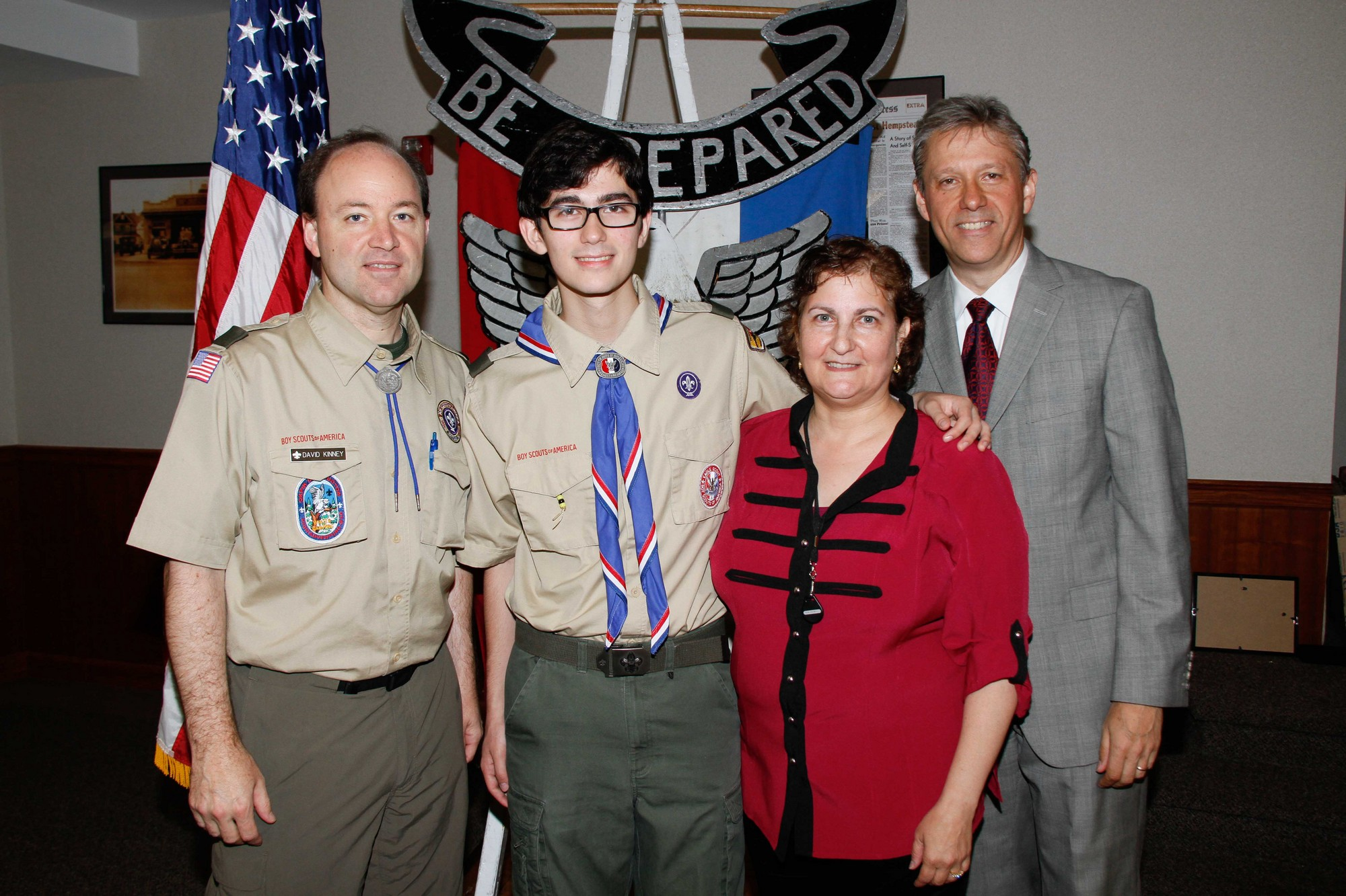 Scout Master David Kinney, left, and Hesselbach's parents, Laura and Robert, right, recognized the Eagle Scout for his dedicated service to the community.