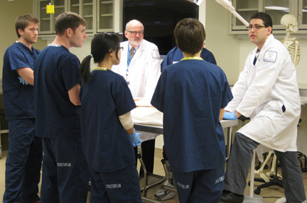 Dr. Keith Metzger, far right, one of Hofstra North Shore-LIJ School of Medicine's first professors, teaches anatomy. Here he was pictured with a class in the school's state-of-the-art laboratory.