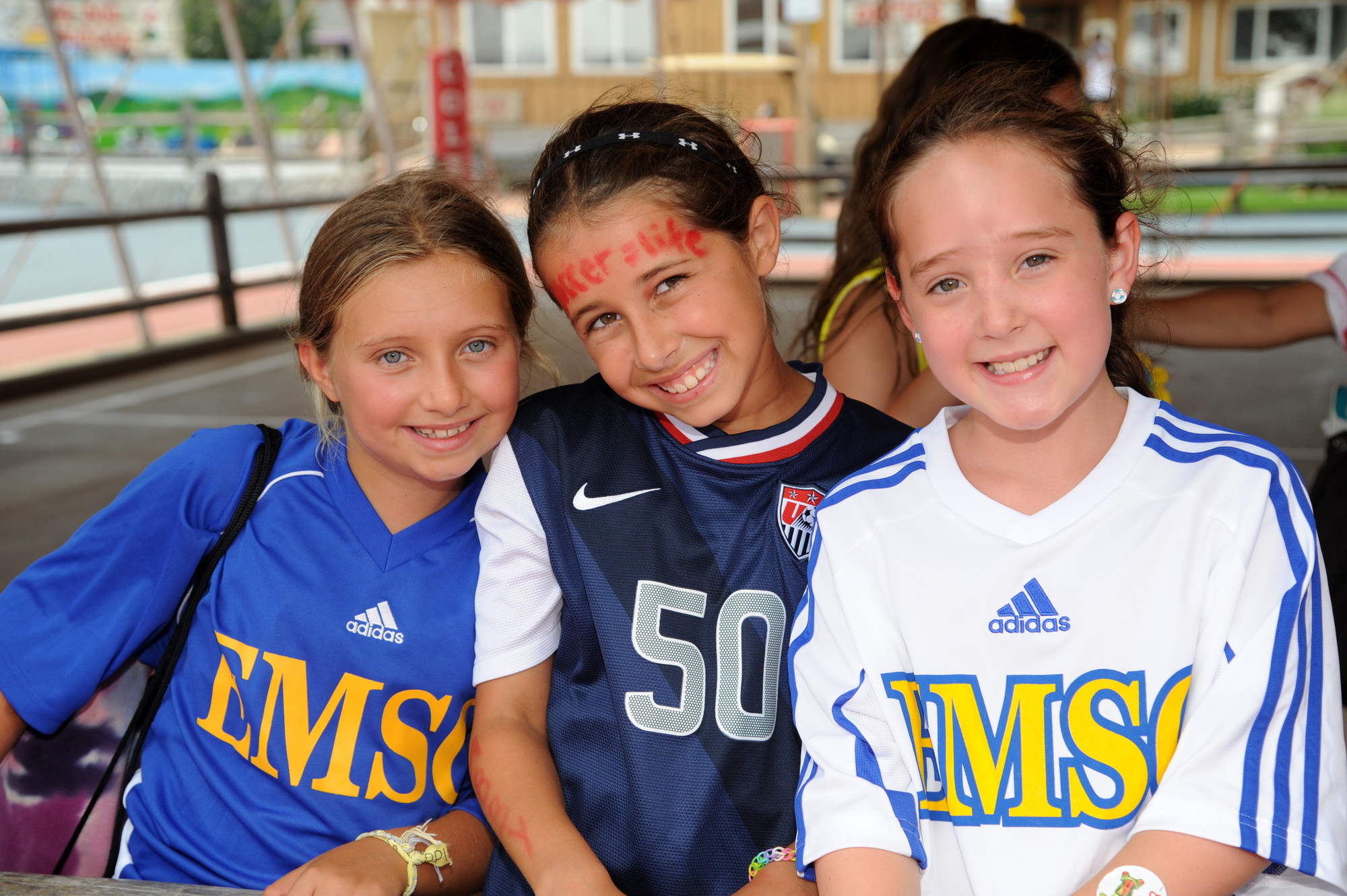 Coleman campers, from left, Arianna Peckham, 9, Samantha Miller, 10, and Rebecca Kussin, 9, who play soccer in the East Meadow Soccer Club, were thrilled to meet Wambach.