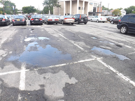 The Parking lot, which is in need of repairs, would cost the village about $340,000 to resurface, accordingly to Len Garden, who represents Browning.