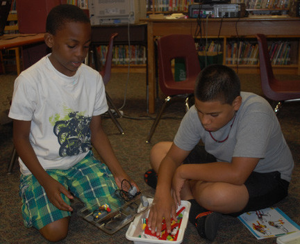 Sixth-graders Akeem Brooks and Nicholas Polanco work with Lego robotics.