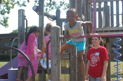 Participants in District 13's summer recreation program enjoy some quality time on the playground.