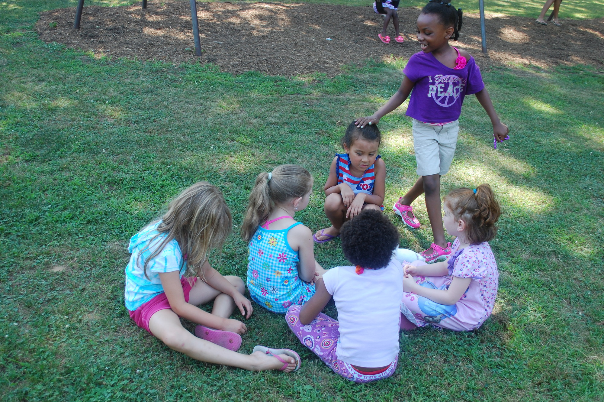 Children entertained themselves with a game of Duck, Duck, Goose.