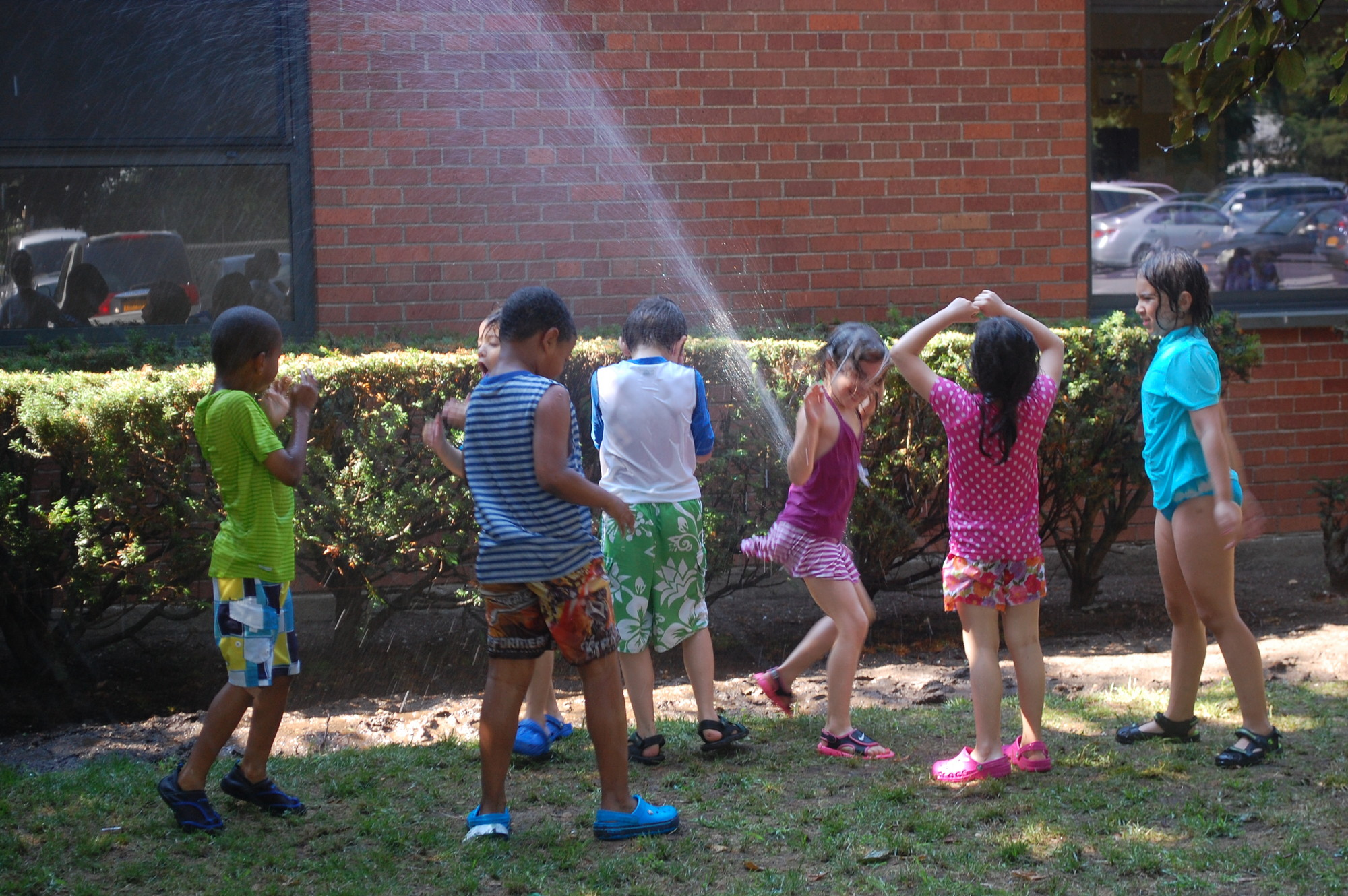 On a hot July day, the sprinkler provided much needed refreshment.