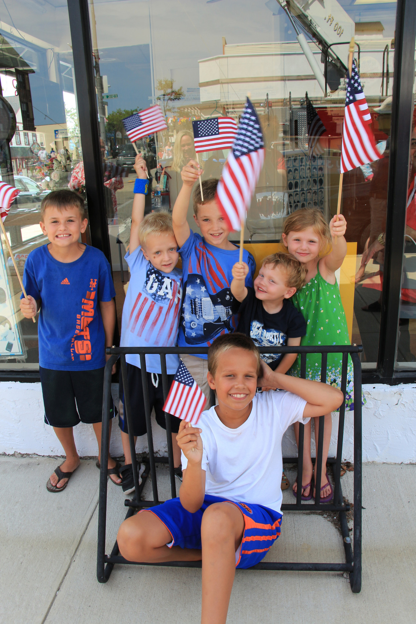 Thomas Wheeler, left, Patrick Henry, Joseph Henry, Jack Wheeler, Anna Wheeler, and Thomas Kelly cheered the soldiers on from the sidewalk.