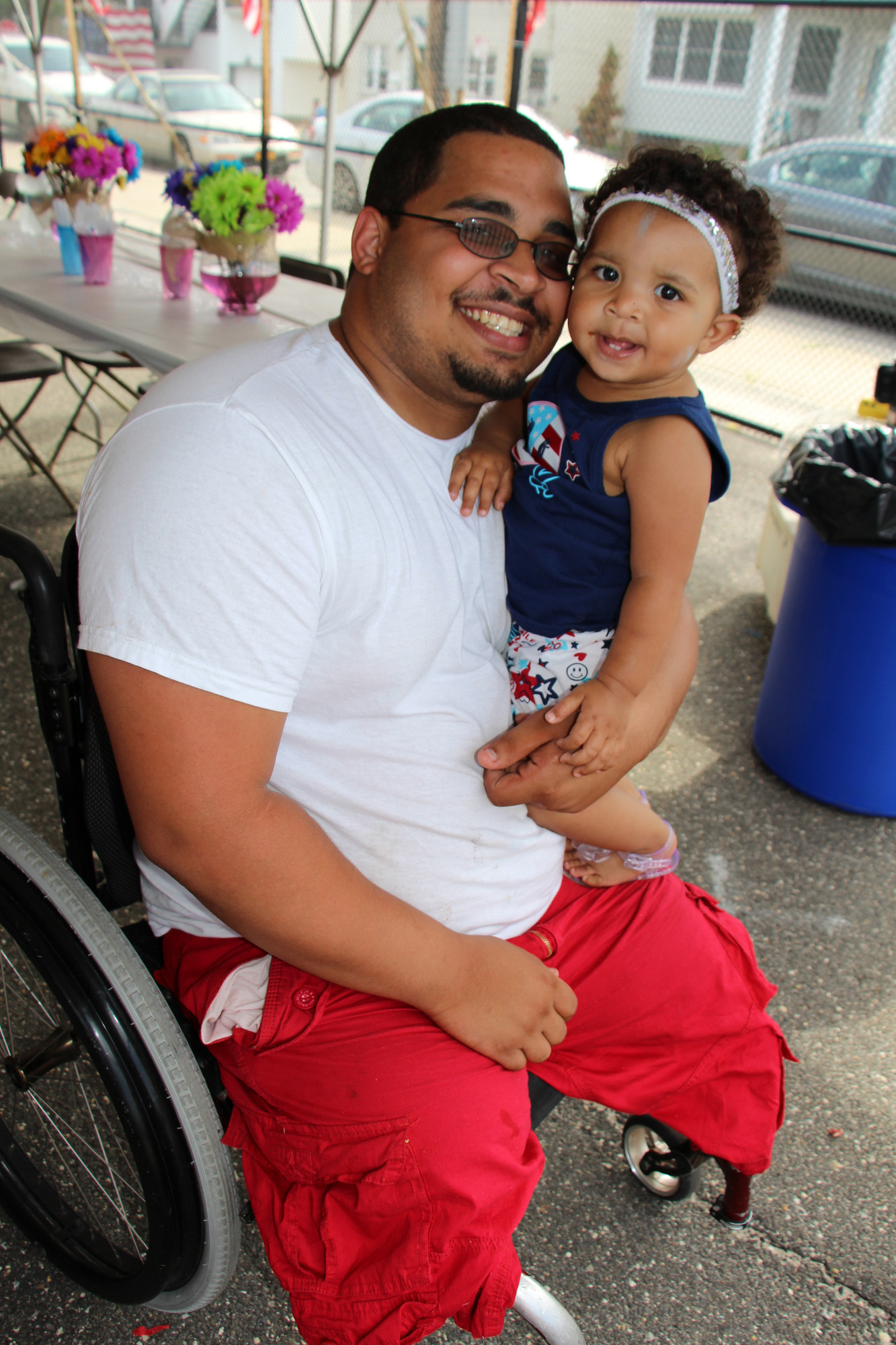 Richie Chavis held his daughter, Madelyn, 1, at the barbecue.
