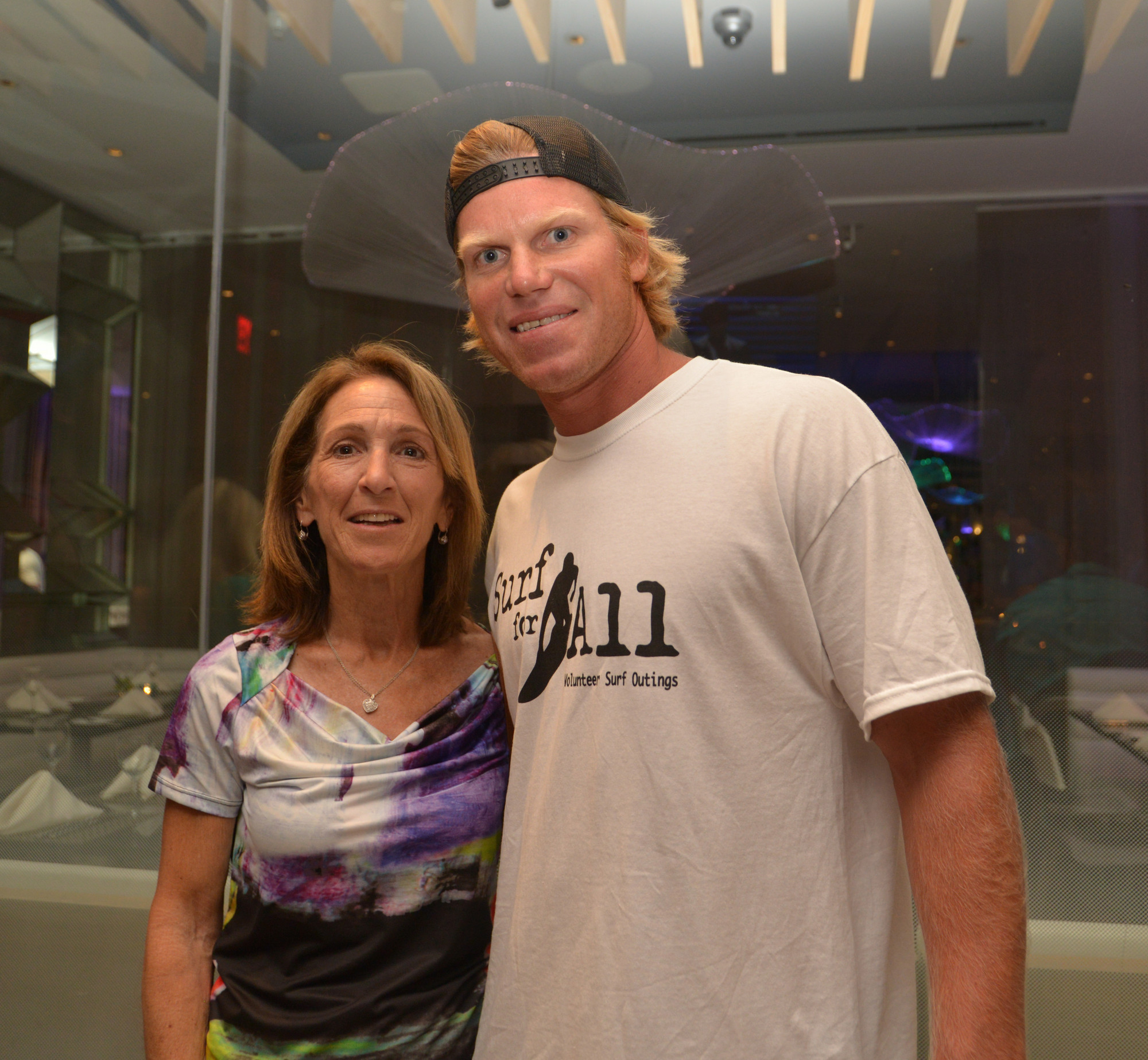 Councilwoman Fran Adelson with Cliff Skudin at the Surf Week art show at the Allegria Hotel.