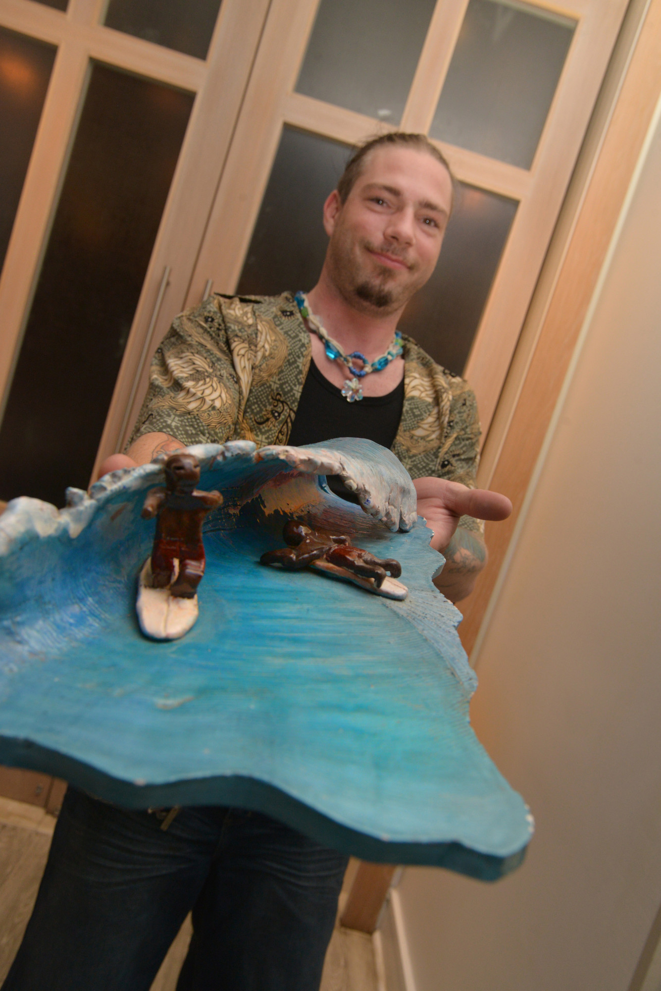 Phillip Eubanks displayed his sculpture at the Surf Week art show at the Allegria.