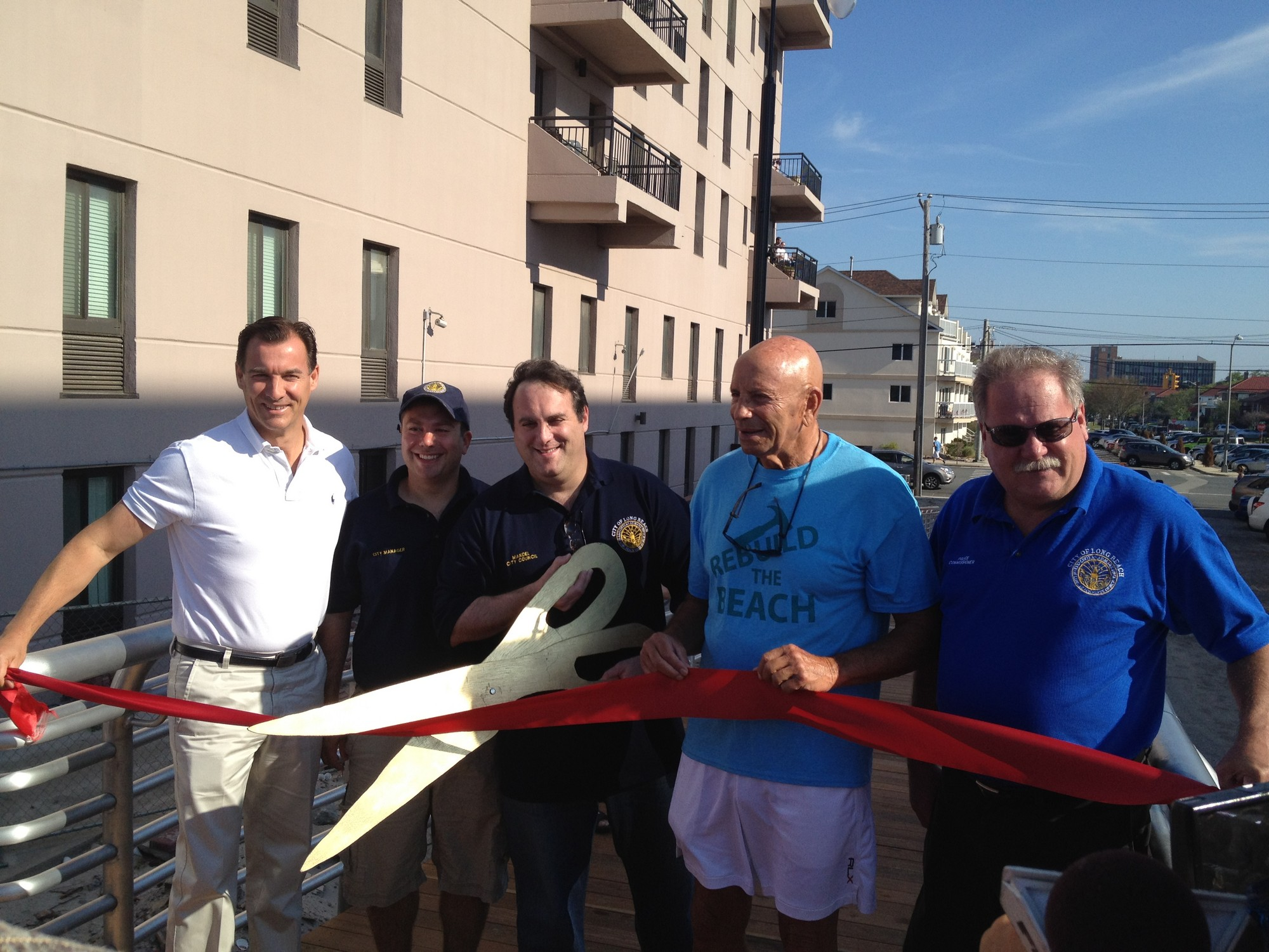 Former Nassau County Executive Tom Suozzi, far left, City Manager Jack Schnirman, Council President Scott Mandel, Assemblyman Harvey Weisenberg and Police Commissioner Mike Tangney at Saturday's ribbon-cutting ceremony.