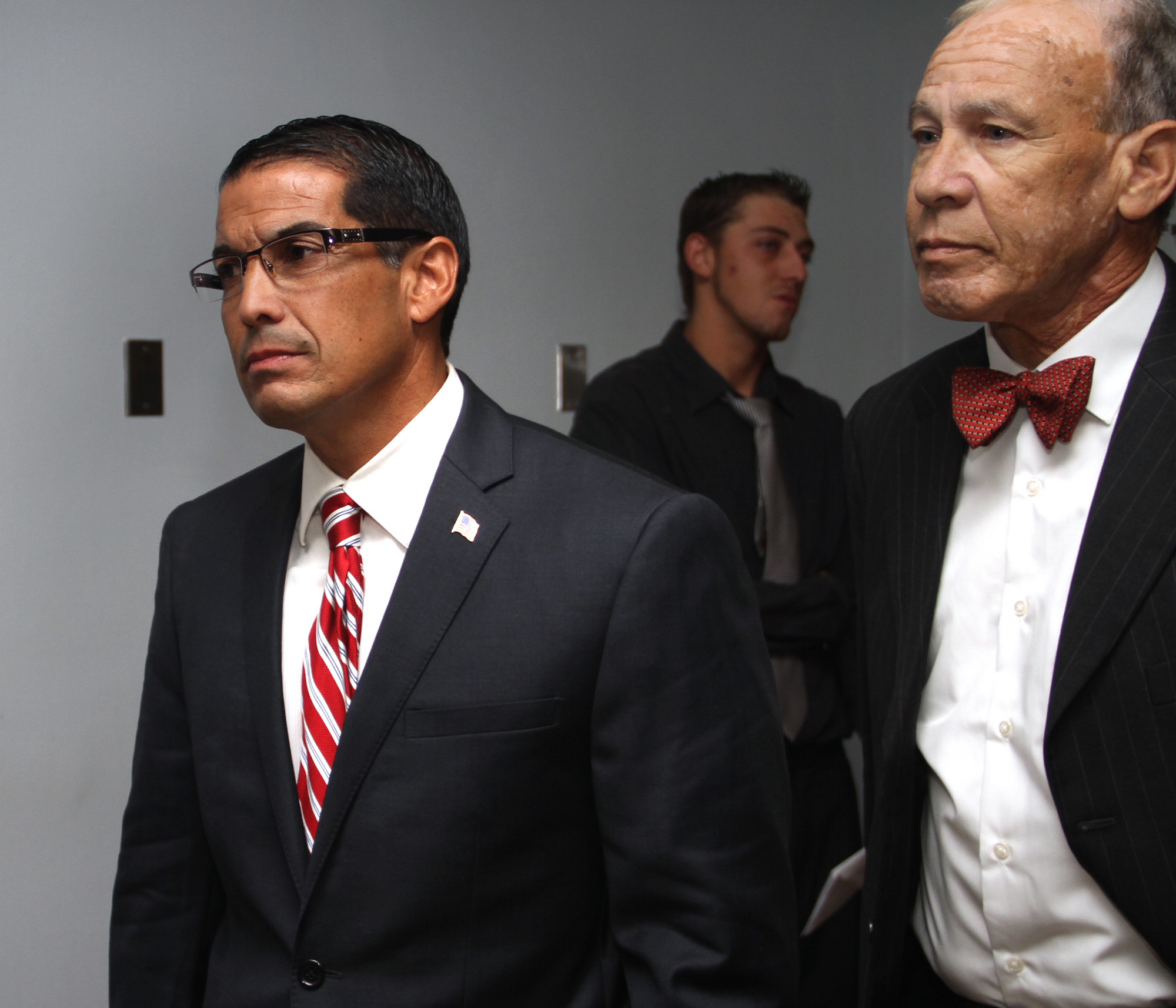 Mark Bonilla and his attorney, Adrian DiLuzio, from left, left First District Court in July after hearing Justice Sharon Gianelli issue her verdict in Bonilla's criminal case.
