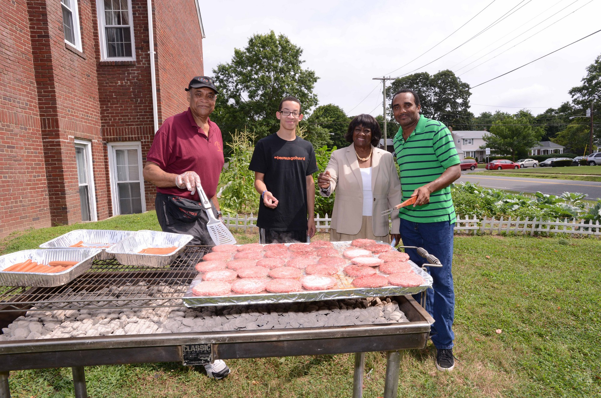 Claude Reed, left, of West Hempstead, Phillip O'Brien, of Hempstead, Councilwoman Goosby and Bobby Vaughan, of Great Neck, grilled up some good eats for the Community Love Feast.