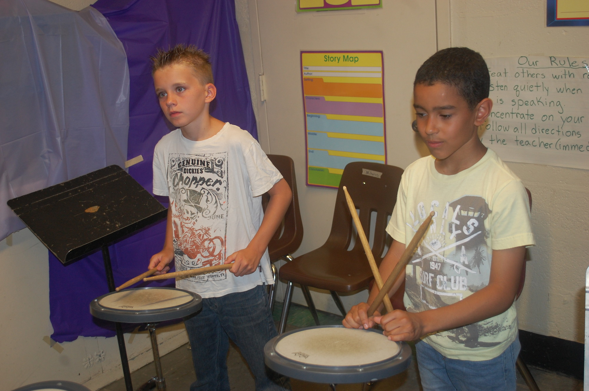 District 13 students Jack Manza, left, and Jacob Marinez are taking music lessons this summer at the Howell Road School.