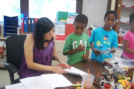 Carrie Richman reviews an assignment for her incoming third-grade students.