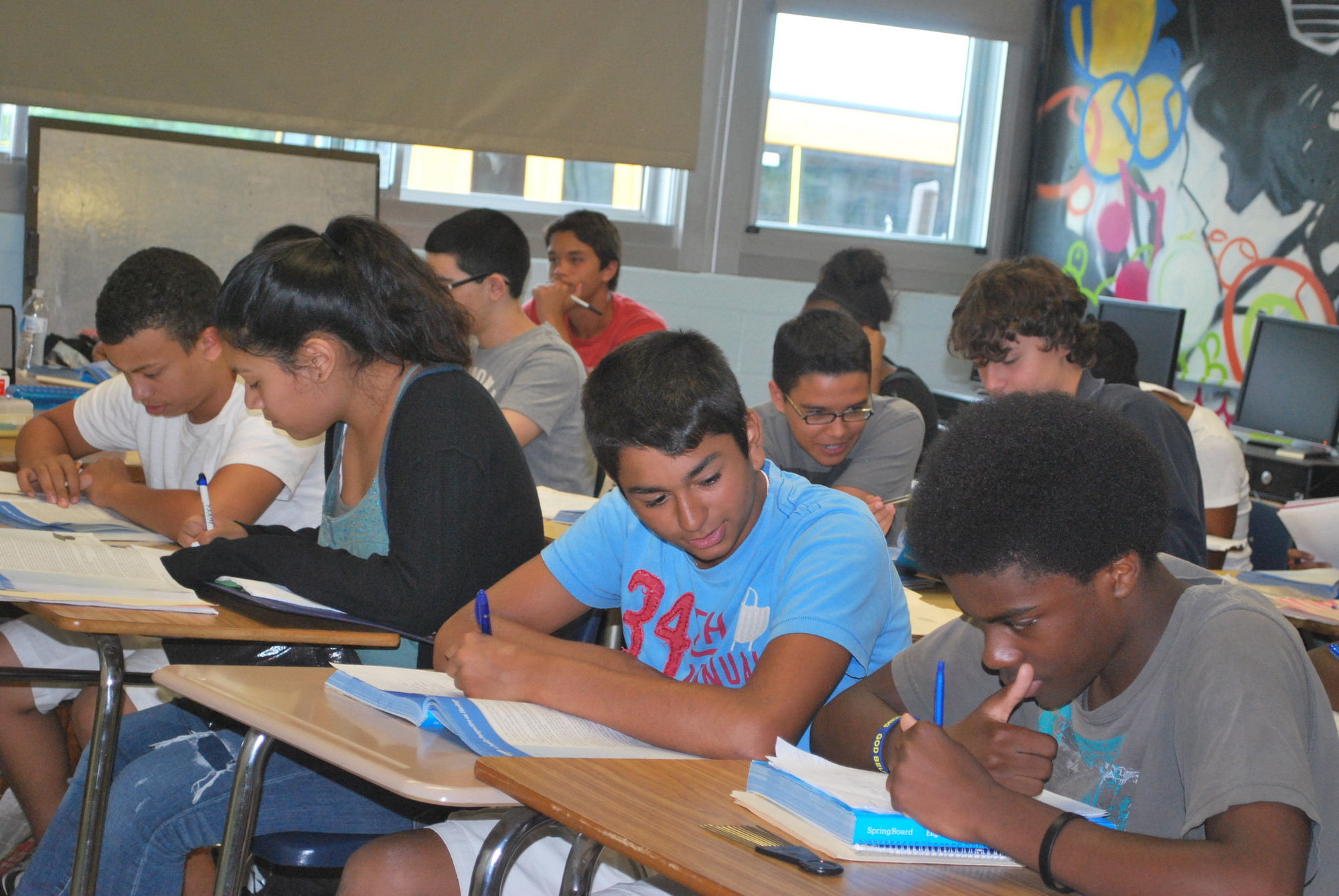 Freshman and sophomores in an Advanced Placement English prep class collaborated on a reading assignment.