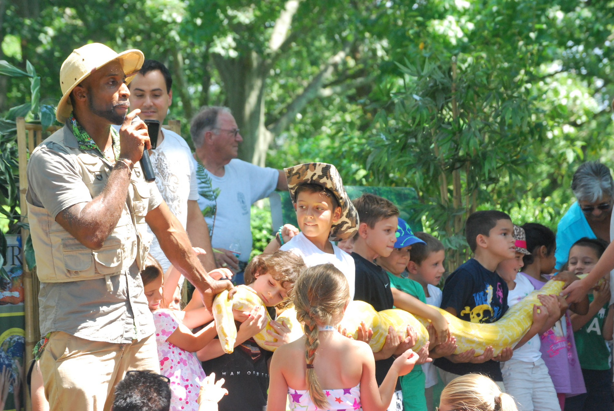 Erk's Reptile Edventure included children holding a 120-pound albino Burme python named Twinkie.
