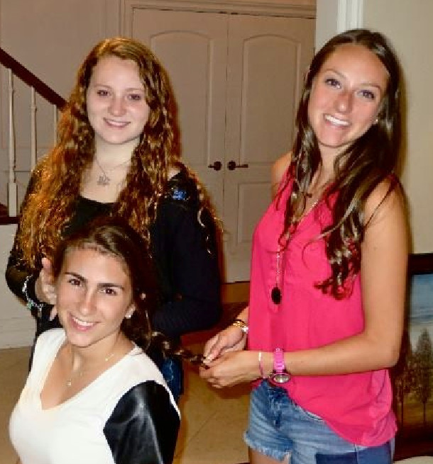 Allison Wanderer had her her hair braided by Samantha Weissman. Rebecca Alenick, center,is part of the group that seeks out unique braids.
