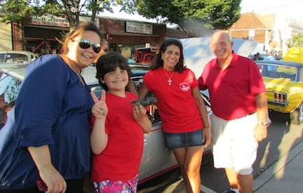 Camp Anchor mom Kim Salerno with her son, Alex, a camper, and camp mom Joann Capobianco, with car show coordinator Rich Cittadino.