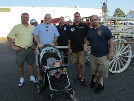 East ROckaway Firefighters with antique engine and 'Tootsie': Joe Mahalik, Mike LaBarbera, James Esrizzo, Dominic Orlando and Gregg Torborg.