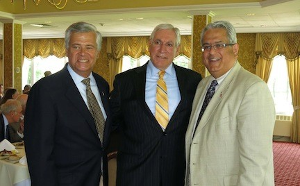 SEn. Dean Skelos, left, and and Town Councilman Anthony Santino were on hand to celebrate with Braverman, center.