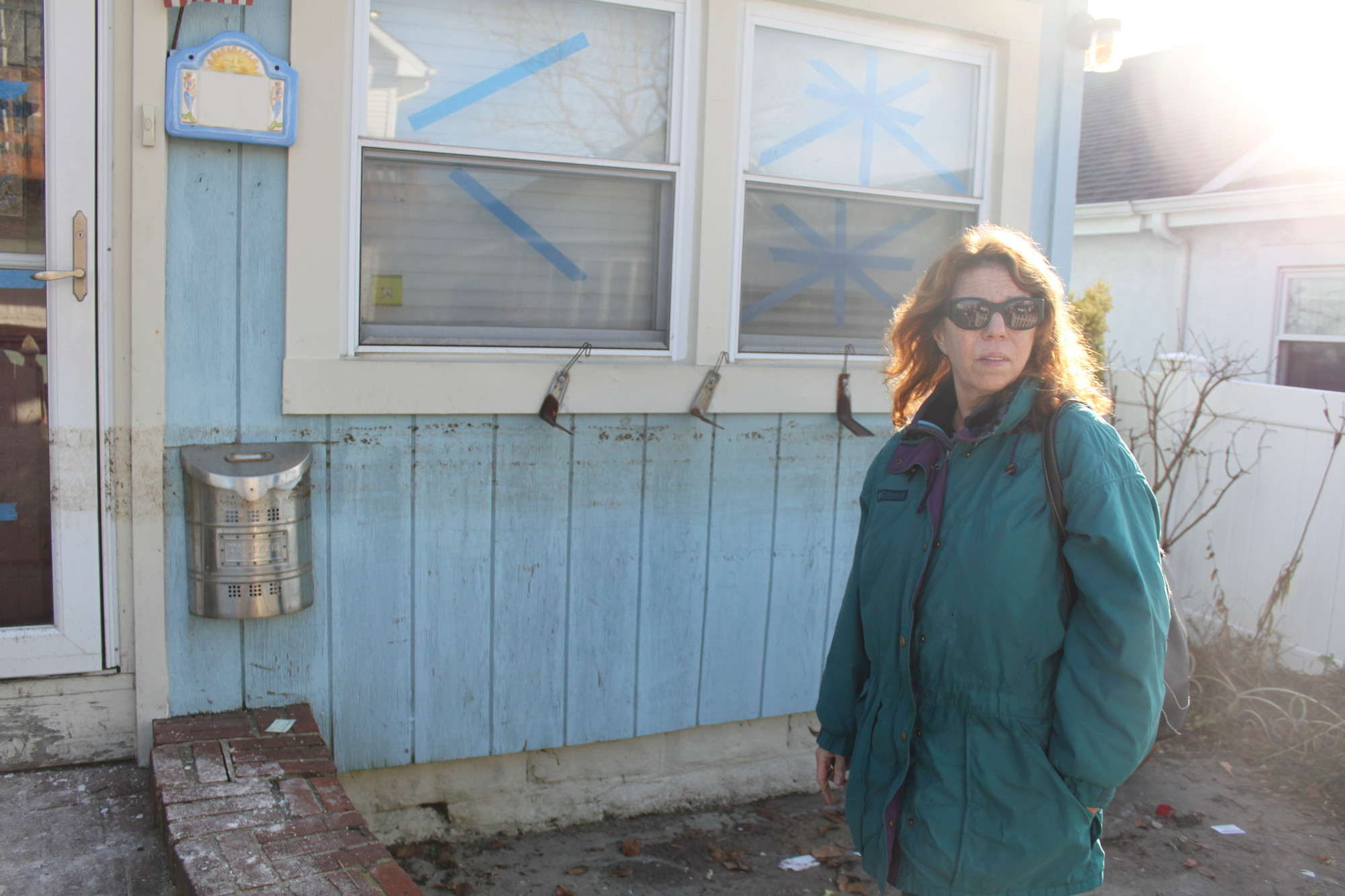Resident Anita Daly, outside her New Hampshire Street home, said that she has yet to return because of federal funding hurdles.