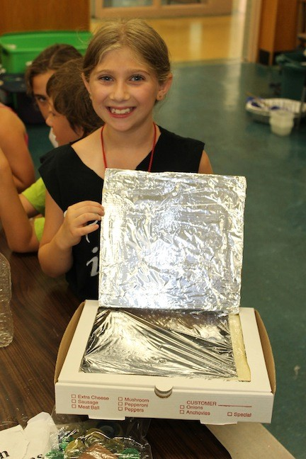Kaitlin Vitti proudly held her new solar oven that she created in the Mad Scientist class at the North Bellmore Foundation for Academics, Enrichment and Recreation.