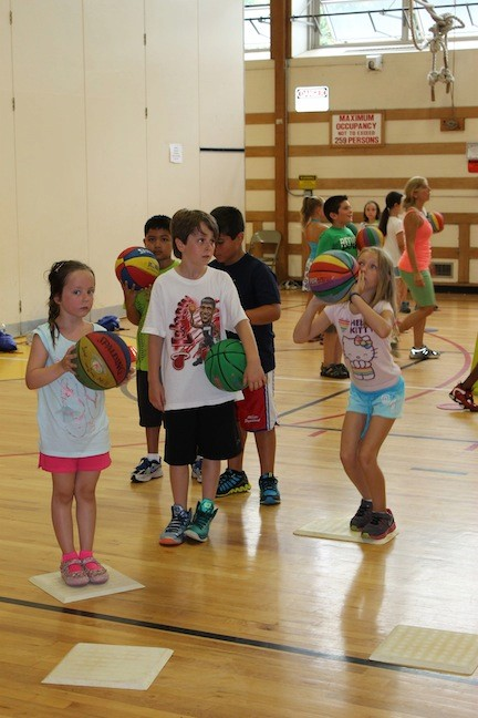 Kids loved basketball in the gym.