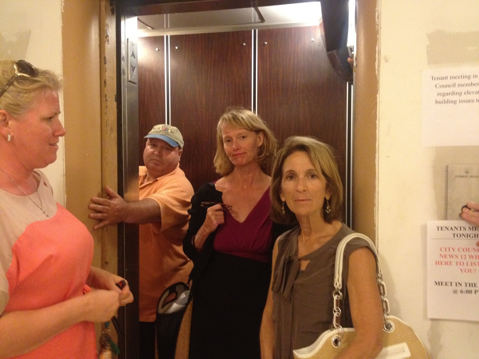 City council members Eileen Goggin, third from left, and Fran Adelson, right, inspected the conditions at 10 Monroe Blvd., on a day when the elevator happened to be working. They said that the city is seeking to impose tougher penalties on negligent landlords.
