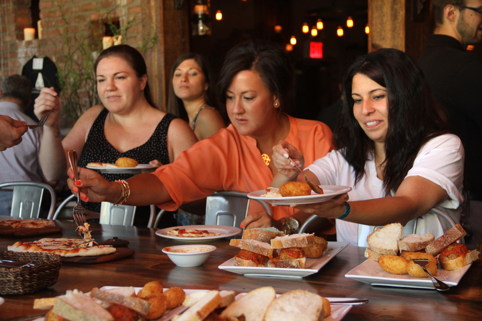 Kristen Melega, Christine Comer and Taline Kharhatoorian help themselves to appetizers.