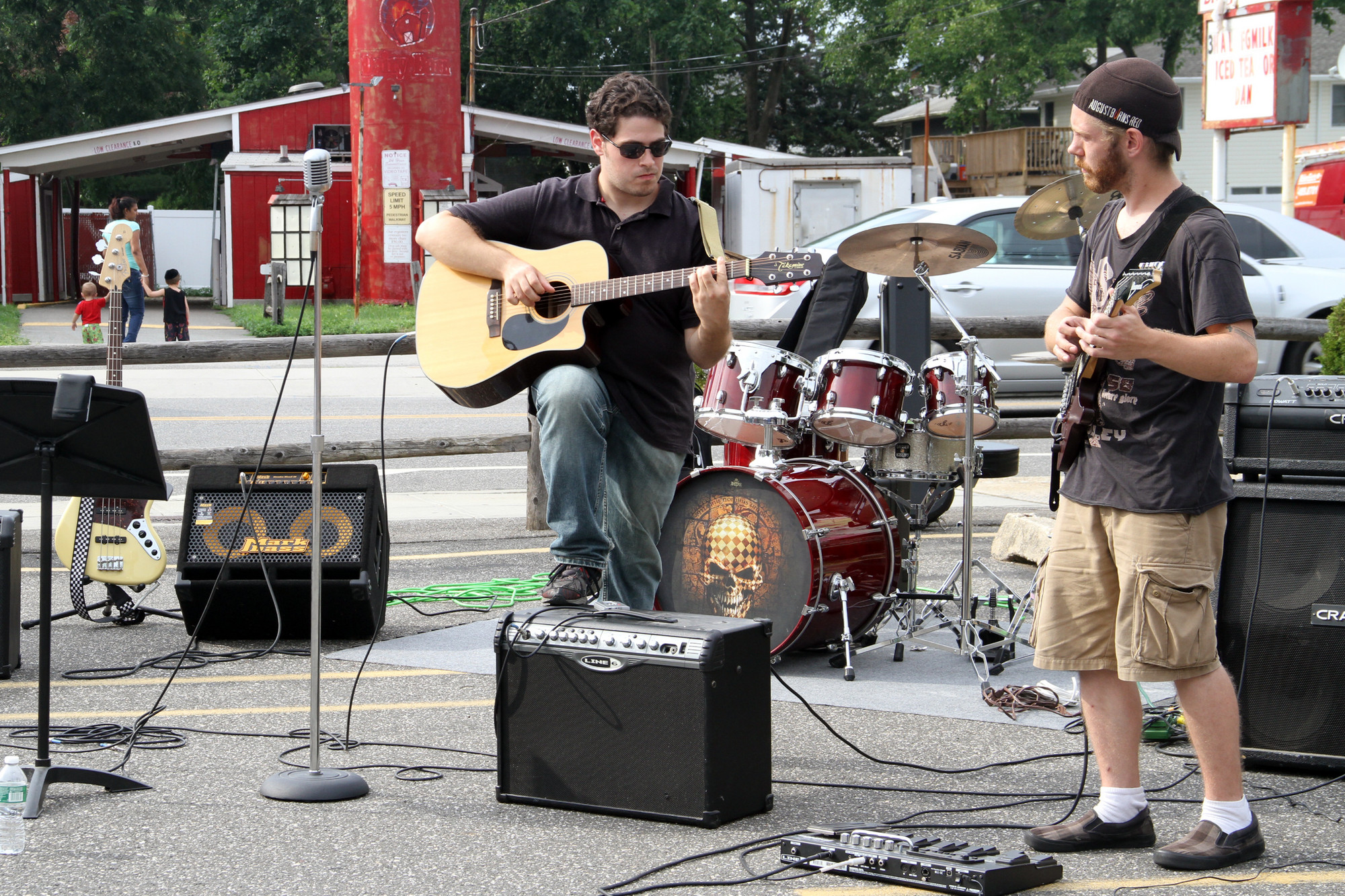 Tom Rizzuto and Ryan Closs perform for the crowd outside Riesterer's Bakery.
