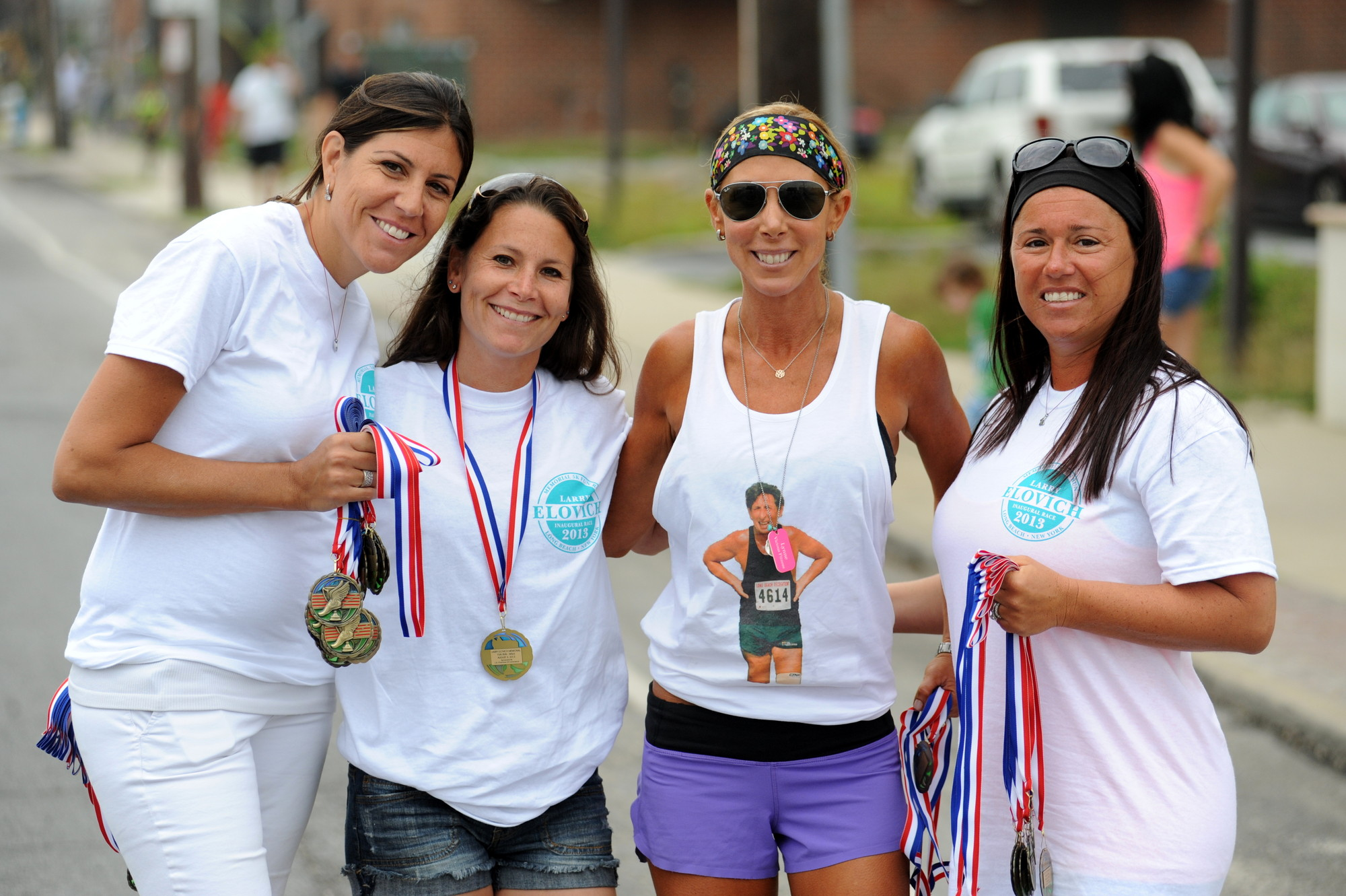 Laura Borawski, far left, Jill Backlin, Elovich's daughter Lynn Eisenberg and Fran Matkin rewarded the runners with gold medals.