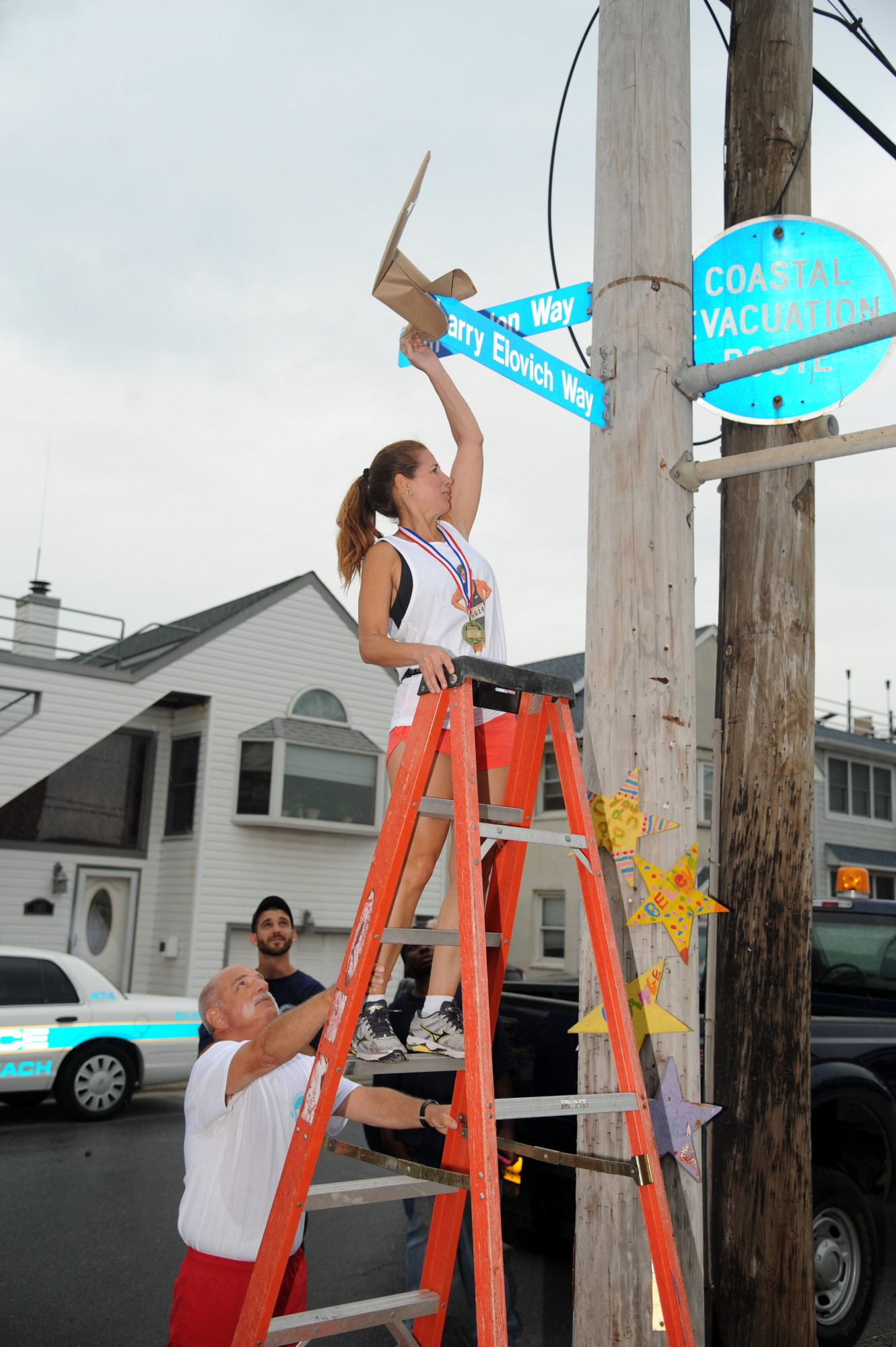 Elovich's daughter, Lisa, unveiled the new street sign in honor of her late father.