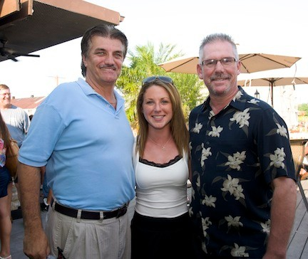 Phil David, left, general manager of The Fishery, and Bar Manager Ken Howley congratulated organized Nikki Roeill for coodinating the fundraiser.