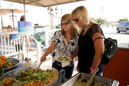 Judy Fahrenkrug and Melissa Hawxhurst tried the salad at the buffet table.