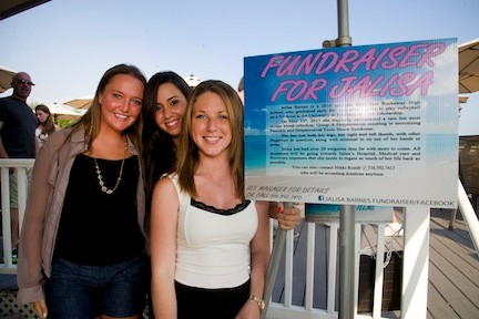 Event Organizers and former classmates Shannon Pujol, left, Briana Costanzo and Nikki Roeill welcomed hundreds of supporters to The Fishery for a fundraiser for their friend, Jalisa. Barnes.
