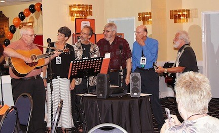 Schlosser, far right, joined with his fellow 1963 East Rockaway High School classmates at their reunion held at the Elks club recently, singing familiar songs from the 60s and 70s. Also pictured were, from left, Bob Johnson, Janice Gook-Dutton, Roberto Schiraldi, Billy Klappholz and Kenny Roemer.