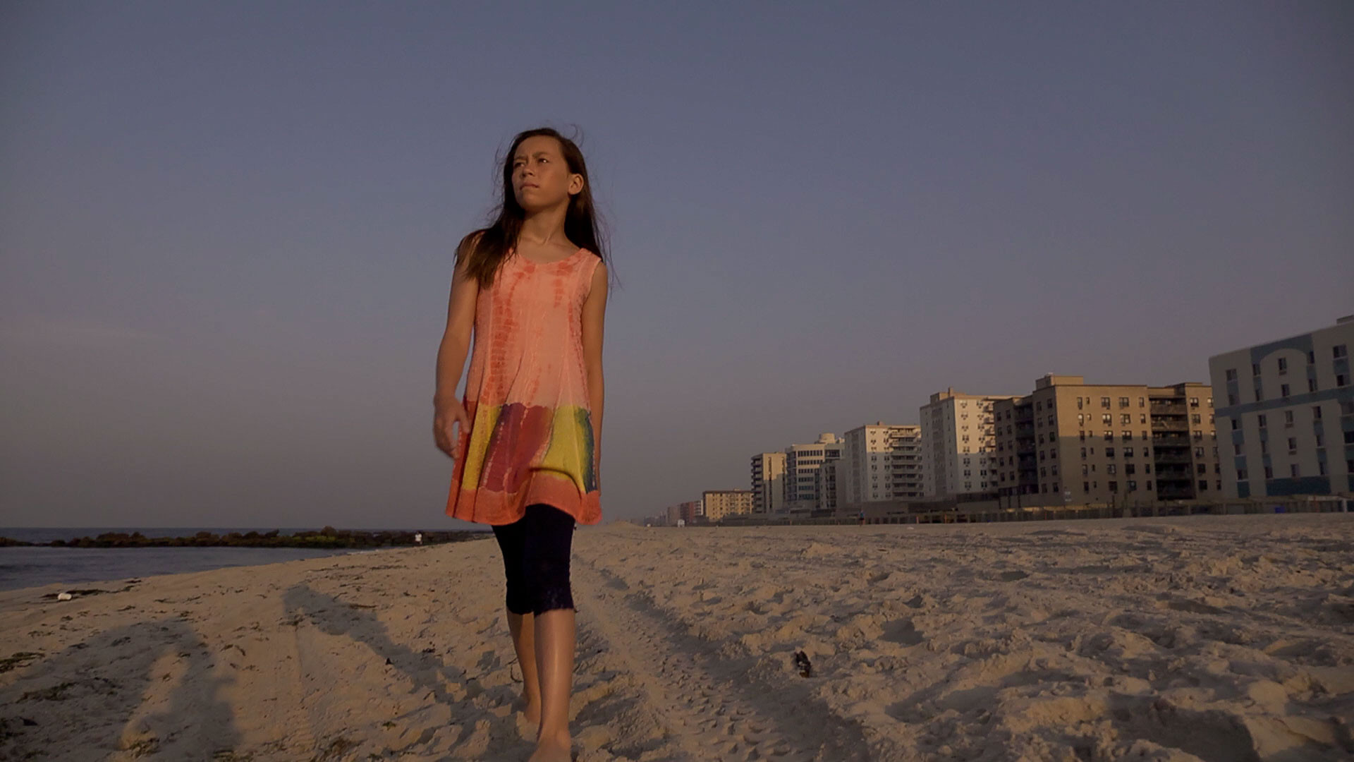 "Yoo, 11, of Garden City, walks along the beach in her music video for the song ""Hang On."""