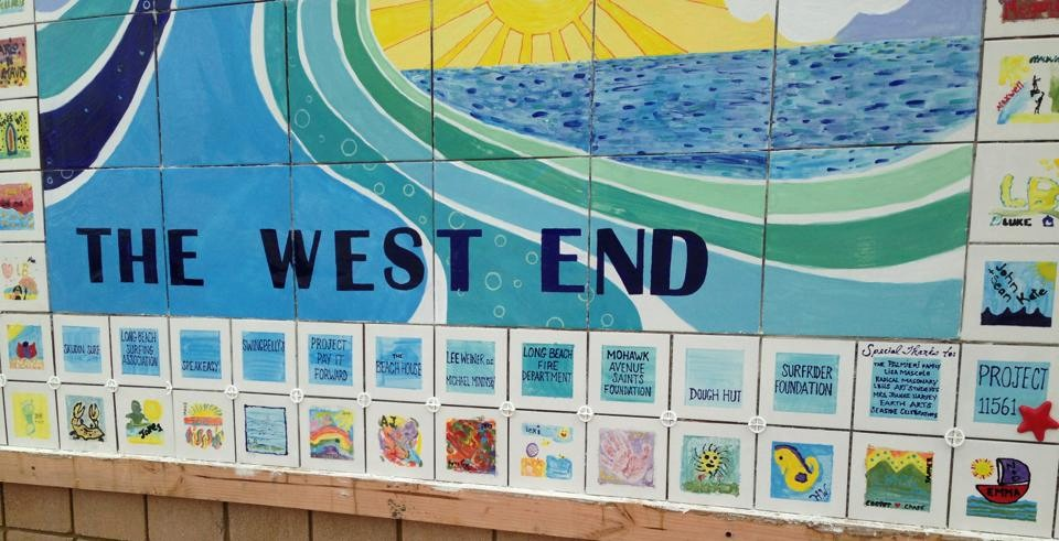 LBHS art students, under the direction of Earth Arts' Michelle Kelly and the Project 11561 ladies, painted the inside wave design, while local children painted the beach scenes that line the border.