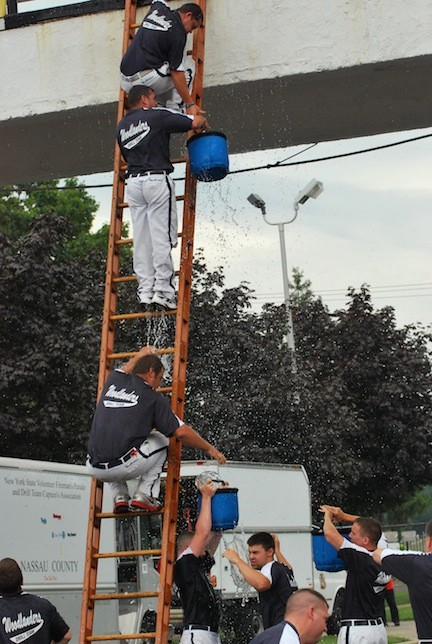Rockville Centre firefighters passed full pails up a ladder in the bucket contest.