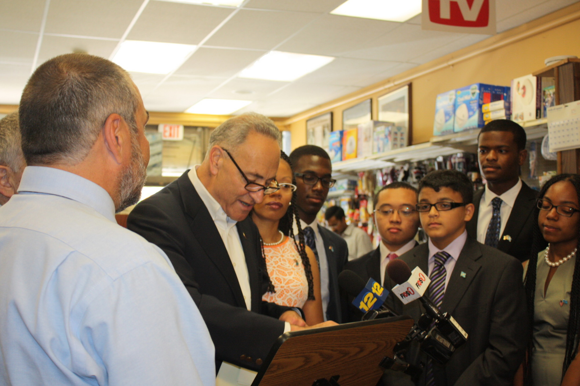 U.S. Senator Charles E. Schumer, center, honored the Elmont Memorial Model U.N. team on Aug. 15 in Farmingdale. Students were presented with proclamations as school Principal John Capozzi, left, proudly watched his team.