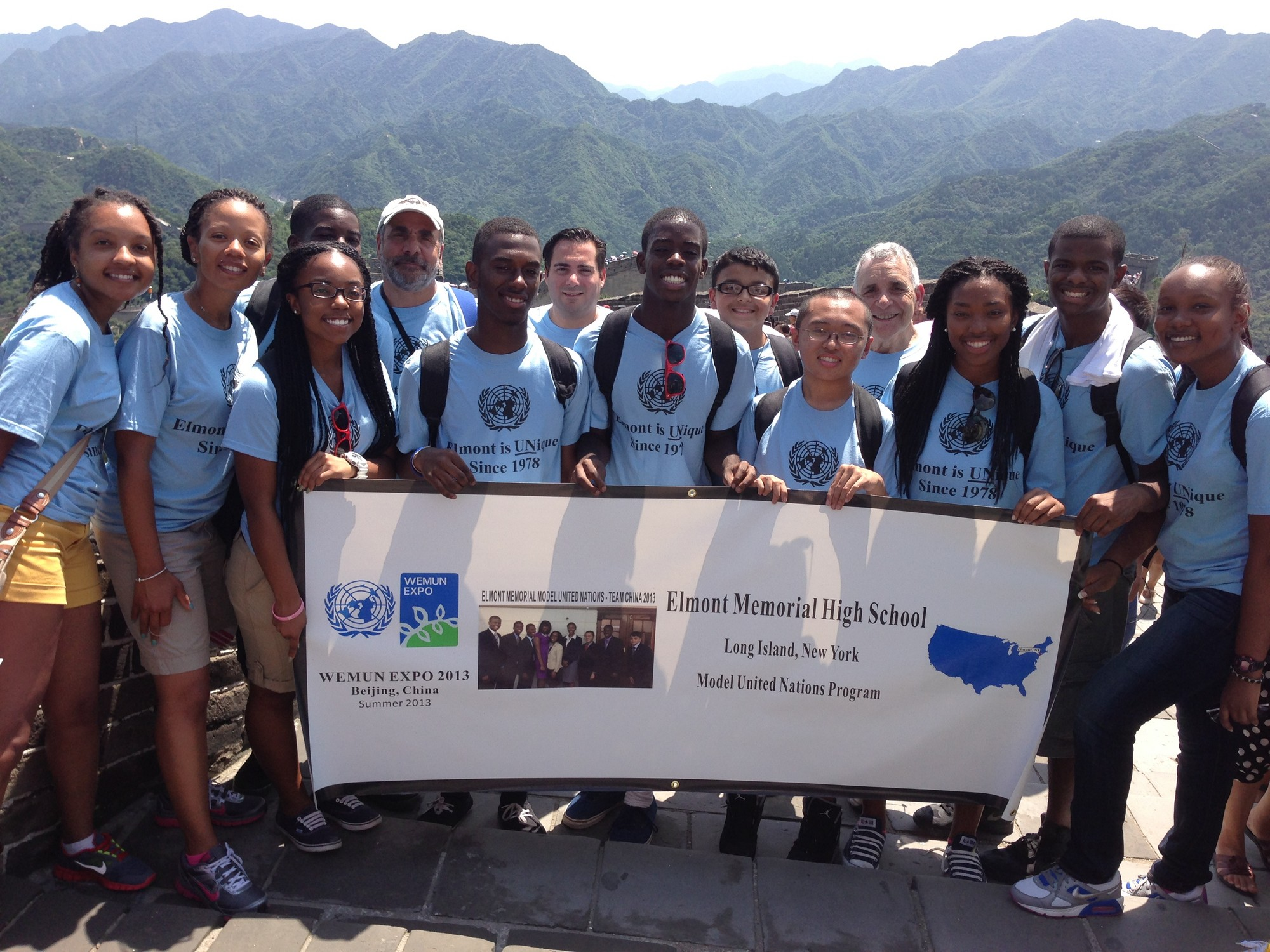 With Beijing as a backdrop, the Model U.N. team from Elmont Memorial High School proudly held its banner during its weeklong trip.