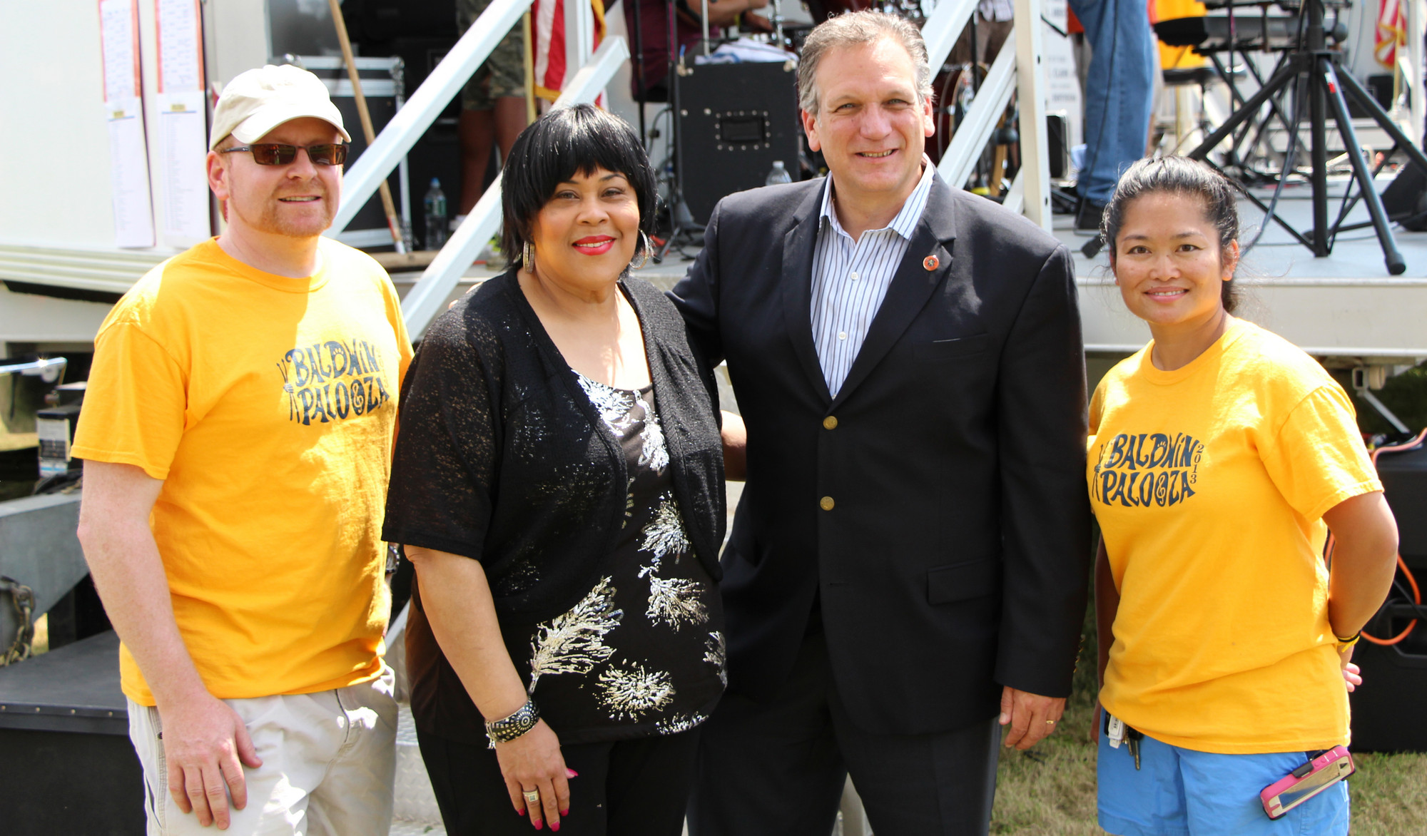 Joel Press, left, Martha Wash, County Executive Ed Mangano and Theresa Press, assembled backstage just prior to Wash appearing before around 700 fans.