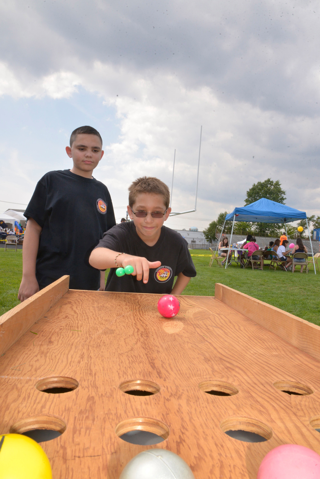 Bobby Erben and Kevin Duryea, both 11, played skeeball — one of the numerous attractions at Baldwinpalooza.