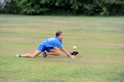 Nicole Morreale dove to catch a fly ball during a recent East Meadow Fillies team practice. The group of 12 girls have been playing together for three years.