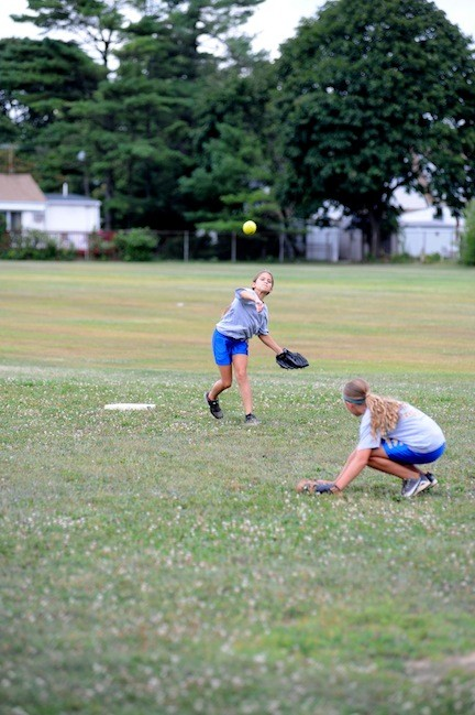 Shortstop Stefanie Botman, 12, fired the ball to first base as the team practiced double plays on the McVey Elementary School playing fields.