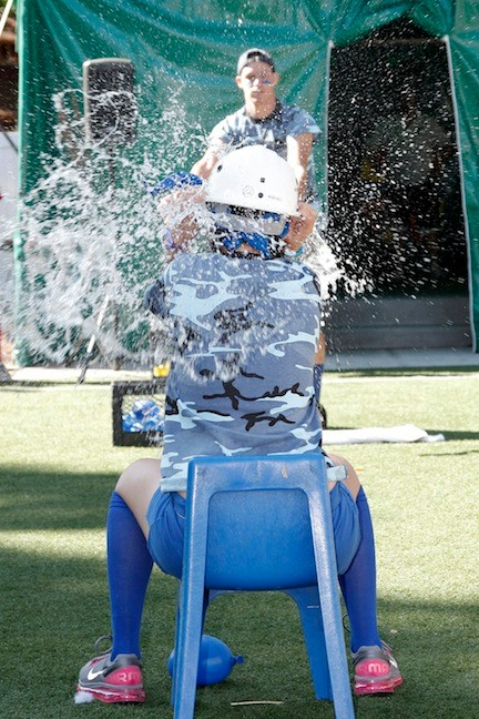 Christian Cederstrom, co-president of the blue team, tossed a water balloon at Paige Passman, the other co-president.