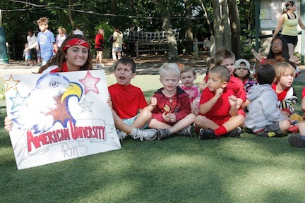 Merrick Woods counselor Victoria DeGiovanni and her 4- and 5-year-old campers lent their support to the red team.