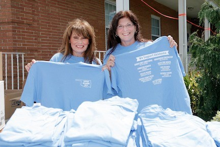 Debbie Kelly, left, and Bridget Perretti staffed the T-shirt sales table.
